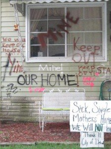 The graffiti Kelly Parker sprayed on her house to deter bidding during Wayne County's tax auction.