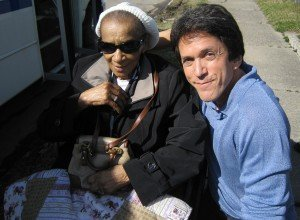 Author Mitch Albom and Texana Hollis after he helped her get her house back and renovated it for her.